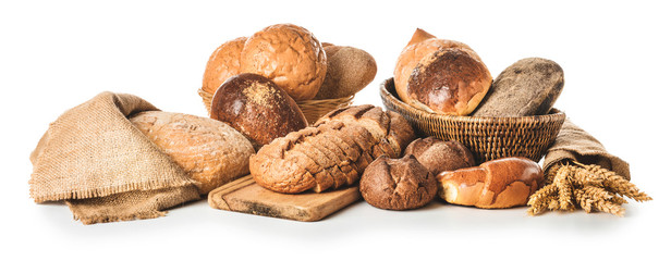 Assortment of fresh bakery products on white background
