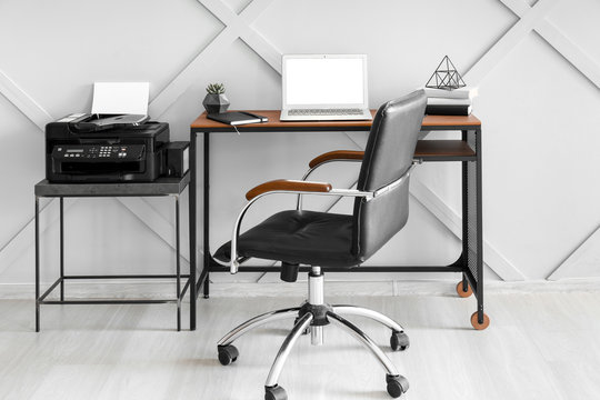 Modern stylish workplace with laptop in office