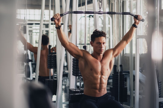 caucasian man in fitness having workout for bodybuilding with weights lifting using gym equipment