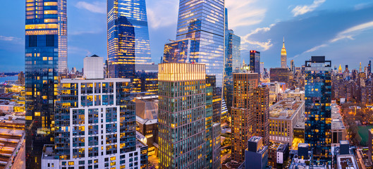 Aerial panorama of New York City skyscrapers at dusk as seen from above the 29th street, close to Hudson Yards and Chelsea neighborhood Fotobehang