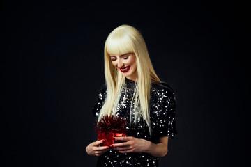Portrait of a beautiful platinum blonde female model isolated on black studio background