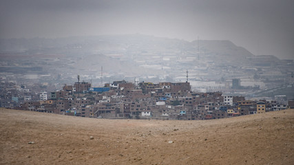 Lima, Peru - Nov 17, 2019: Urban developments expanding into the deserts on the outskirts of Lima