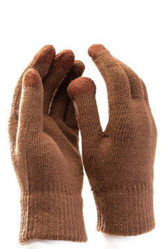 wool knitted gloves brown on white background, touch gloves for smartphones