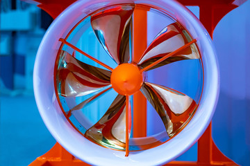 Orange screw with blades. Rotary screw of the ship. Shipbuilding. Turbine engine vessel. The turbine helps to turn the ship. Boat parts. Ship installations.
