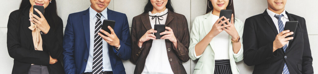 Cropped image of Group of Businesswomen and Businessmen using smartphones.
