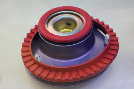 Closeup top metal block bearing car shock absorber strut McPherson, vehicle suspension spare parts