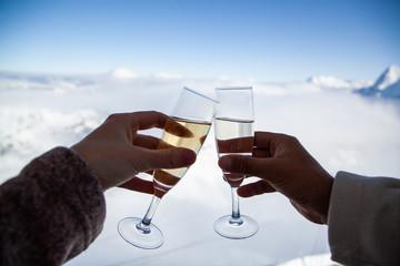 couple drinking champagne and snowy mountains winter holiday