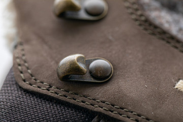 close-up picture of brass shoe hooks. Detail of trekking shoes hook and loop for strap.
