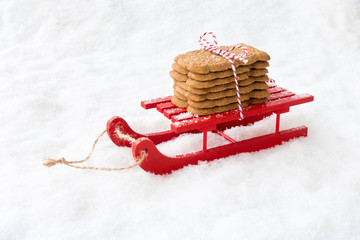 Spiced Christmas Cookies, Spekulatius, Speculaas, Speculoos on Sledge in Snow