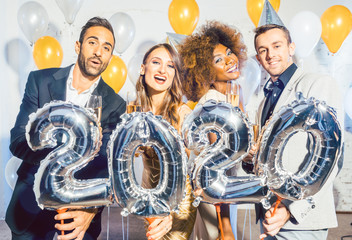 Party people women and men celebrating new years eve 2020
