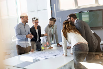 Wall Mural - Group of coworkers working together on business project in modern office