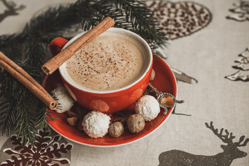Cozy Christmas cup of coffee, magic evening at home. Scene of holidays detail