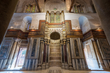 Mausoleum of Sultan Qalawun with decorated colorful marble niche - Mihrab - embedded in decorated marble wall, and colorful stain glass windows, Moez Street, Gamalia District, Medieval Cairo, Egypt
