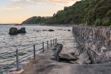View towards Meadfoot Beach, Torquay, Torbay, England, UK - with the broken slipway in the foreground
