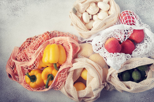 Fresh vegetables and fruits in eco bags. Zero waste shopping