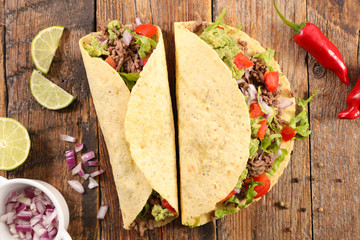 tacos with beef, avocado and tomato- tortilla bread