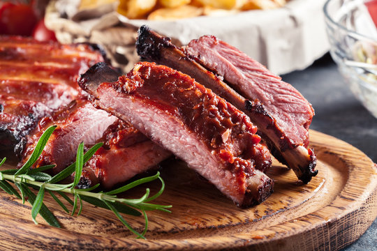 Spicy barbecued pork ribs served with BBQ sauce
