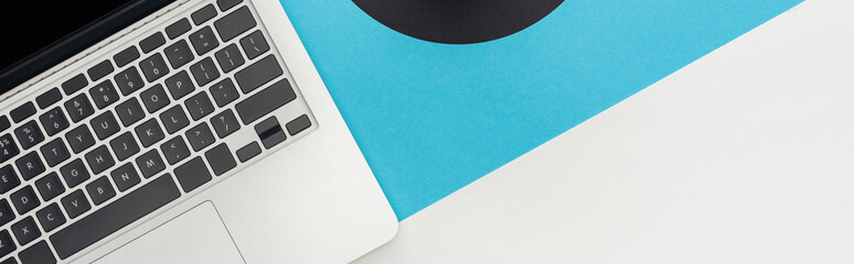 top view of laptop on abstract geometric background, panoramic shot