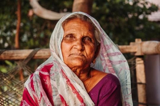 Closeup portrait of an old Indian woman wearing saree