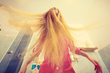 Woman with long windblown blonde hair