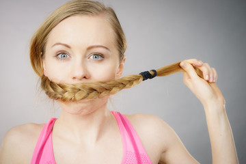 Woman covering her mouth with blonde braid