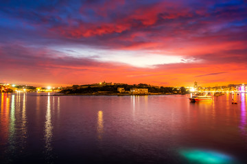 Colorful sunset sky and cloud in twilight time background. Landscape of Sliema, Malta.