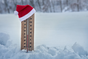 Wooden thermometer dressed up in Christmas hat