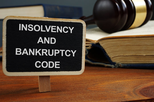 Writing note showing the text insolvency and bankruptcy code