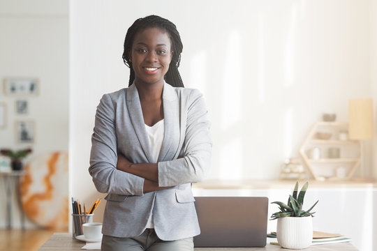 Successful Afro Businesswoman Posing In Office With Arms Crossed