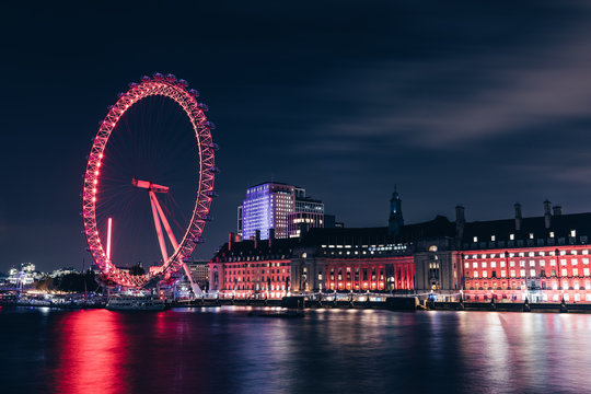 LONDON - NOVEMBER 20, 2019: London eye wheel on modern city skyline at night