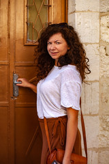Portrait of a young woman at door in the old town if Jerusalem