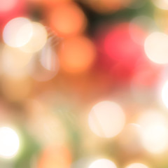 Christmas tree bokeh blur abstract background for merry x'mas party and new year celebration in red green gold color for xmas holiday night light