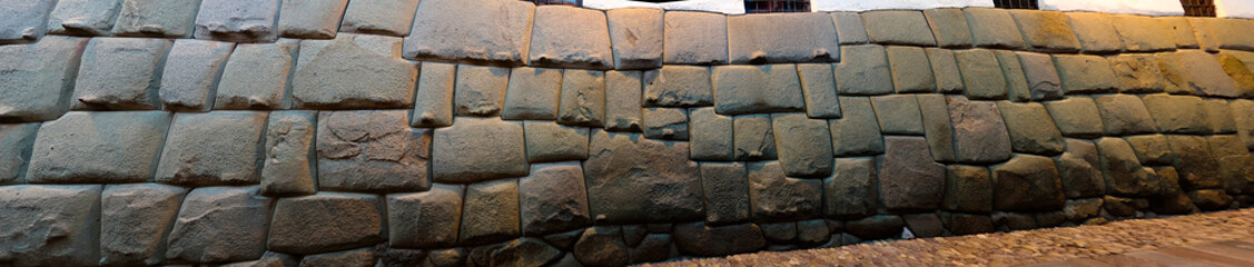 View to Twelve-angled stone aka Hatun Rumiyoc as a part of a wall of the palace of the Archbishop of Cuzco, Peru