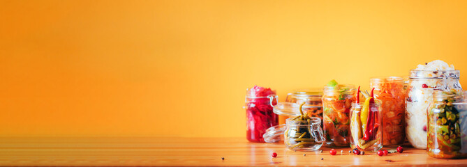 Keuken foto achterwand Eten Probiotics food background. Korean carrot, kimchi, beetroot, sauerkraut, pickled cucumbers in glass jars. Winter fermented and canning food concept. Banner with copy space