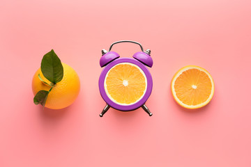 Ripe orange and slices on color background
