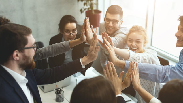 We did it! Business people giving high-five