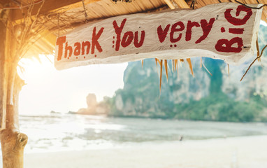 """""""Thank You very BIG"""" sign in exotic bungalow on the sandy Thai beach. Tropic vacation concept image."""