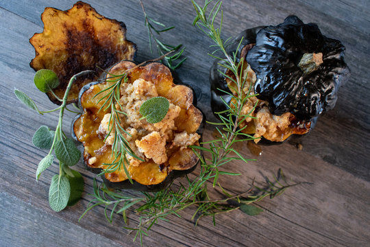 Baked acorn squash bowl with stuffing with rosemary and sage rustic flat lay