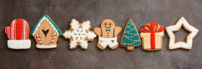 Christmas festive border gingerbread on a dark rustic grunge background. Top view, flat lay