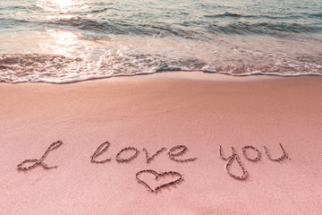 Valentine's day on the beach. Love message and heart on the beach. Travel and holidays concept. Space for text.