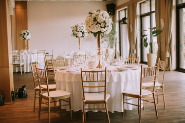 Wedding banquet tables with flowers decoration