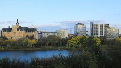 Scene of Saskatoon, Canada cityscape over river