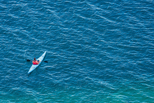 aerial photo of kayaker on lake