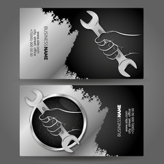 Business card concept handyman wrench in hand for repair