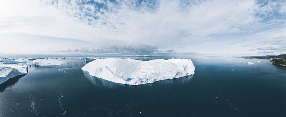 Icebergs drone aerial image top view - Climate Change and Global Warming. Icebergs from melting glacier in icefjord in Ilulissat, Greenland. Arctic North Pole nature ice landscape in Unesco World