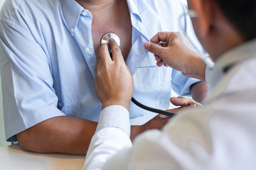 Doctor using stethoscope to listen checking Heart rate measuring to a patient in the hospital