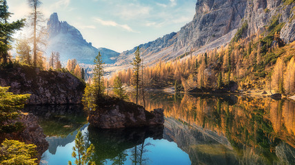 In de dag Diepbruine Amazing Federa lake, natural Scenery, during Sunrise. Awesome Landscape. Foggy Dolomites Alps with forest under sunlight. Travel in nature. Beautiful sunrise with Lake and majestic Mountains.