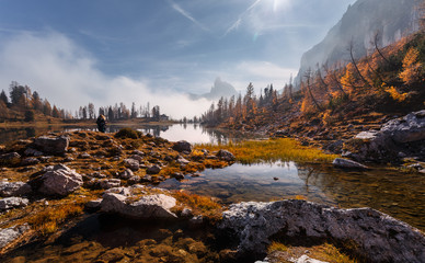 Fotomurales - Amazing Scenery of nature with sunlight. Magical Mountain lake Federa at Dolomites Alps glowing sunlit. Wonderful picturesque Scene at Autumn Highlands. Postcard. Awesome Sunny Landscape