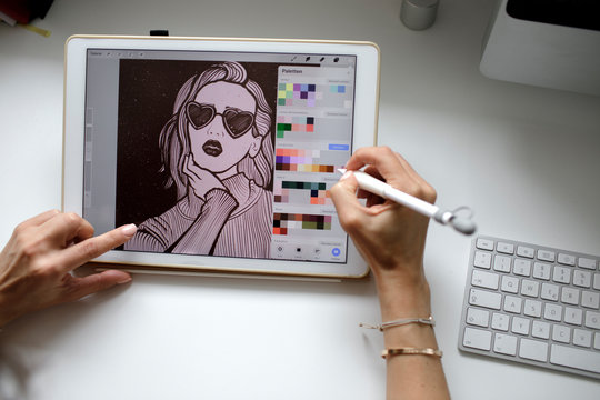 Female web designer using tablet at home