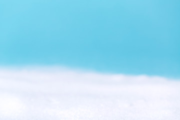 Blurred winter white snow and blue sky background